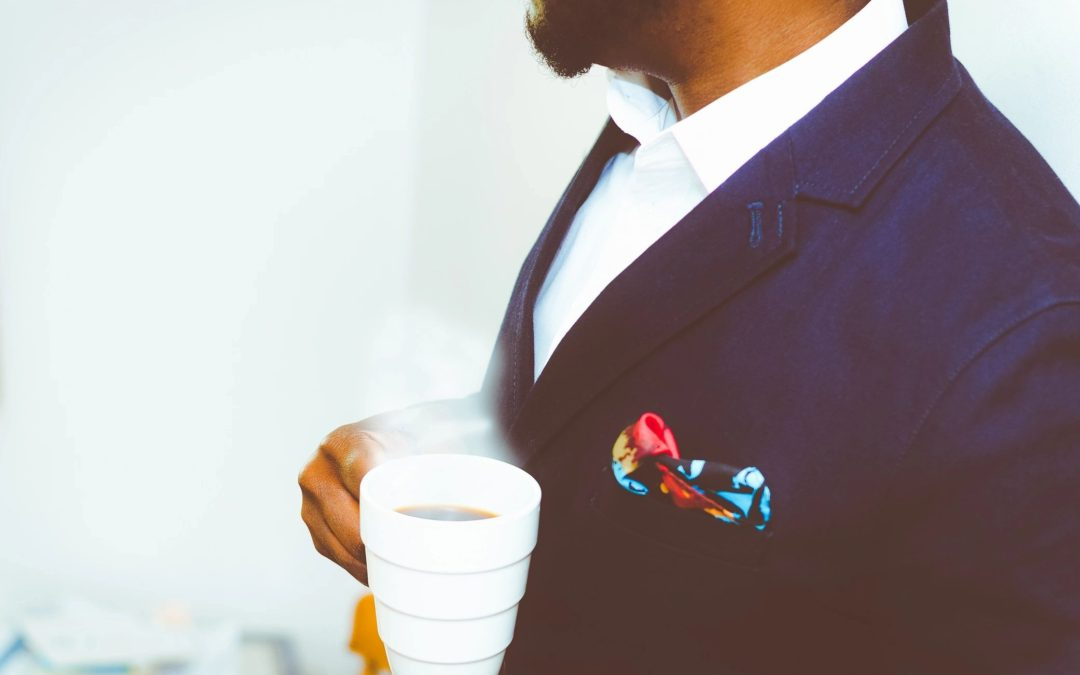 Atlanta anxiety therapy - Man in a suit holding coffee
